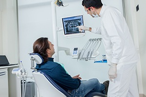 Man looking at x-rays with dentist
