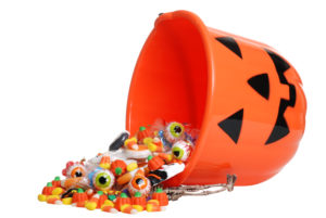 bucket overflowing with halloween candy